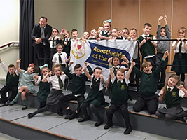 Pupils touching prayer for seafarers
