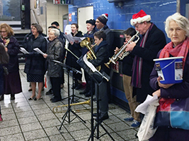 AoS brings Christmas cheer to commuters